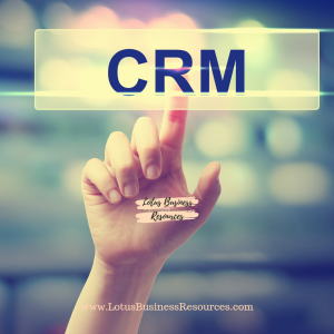 A FINGER PUSHING LETTERS THAT SPELL CRM with the Lotus Business Resources.com address below and the logo above
