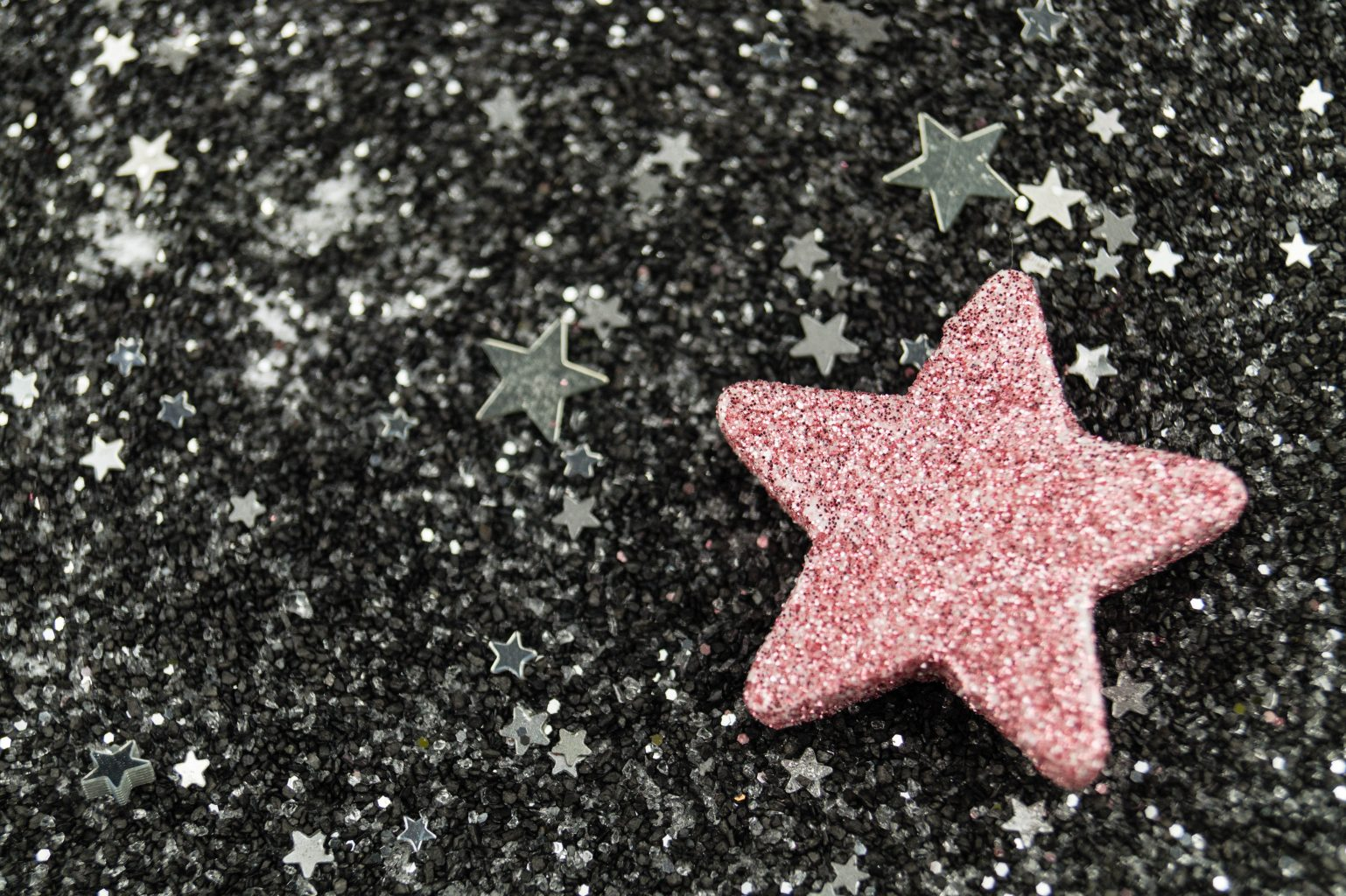 Pink Star on black and white marble table